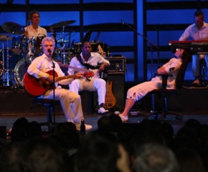 David Byrne and company on office chairs