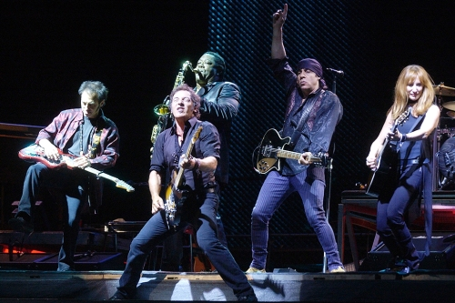 Is Nils Lofgren floating on the left?